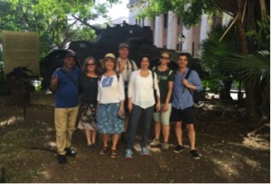 (From left to right, Carlos, a Cuban social worker and professor, Alison Hawthorne Deming, Wendy Harding, Scott Slovic, Sylvia Torti, Susie Bender and Blas Falconer in front of the tank driven to the University of Havana just after the revolution.)